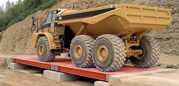 photo of a mining truck  on a weighbridge